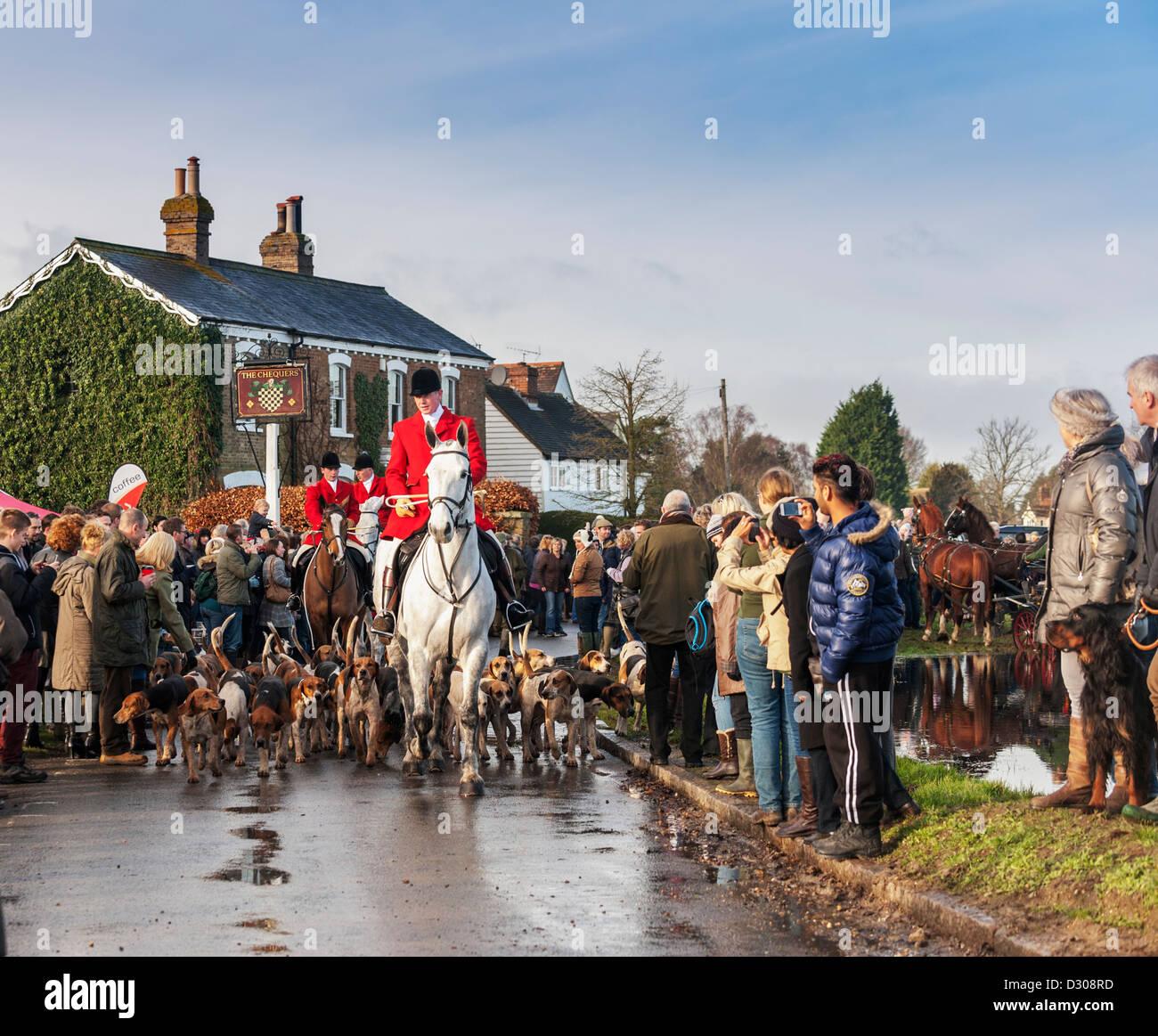 Fuchs-Jagd - The Essex Hunt in der passenden Dorfanger, England, Großbritannien am zweiten Weihnachtstag Stockbild