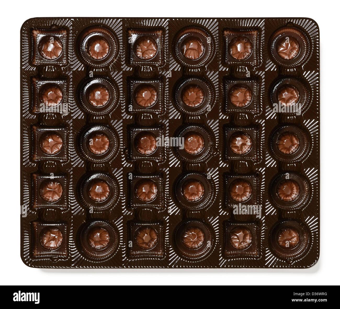 Kunststoff-Tablett aus einer Schachtel Pralinen Stockbild