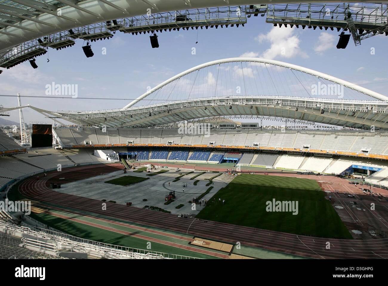 (Dpa) - berührt am frühen Morgen, die Sonne einen tiefen Schatten über den Feldbereich des Olympiastadions in Athen, Stockfoto