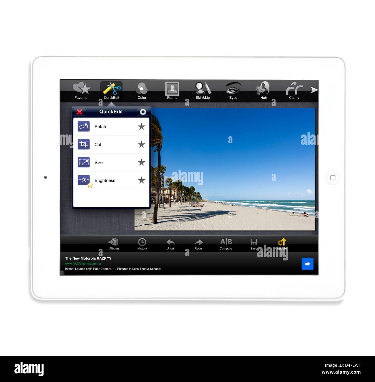 Bearbeiten ein Foto mit der kostenlosen app von Fotolr HD auf eine 4. Generation Apple iPad, USA Stockbild