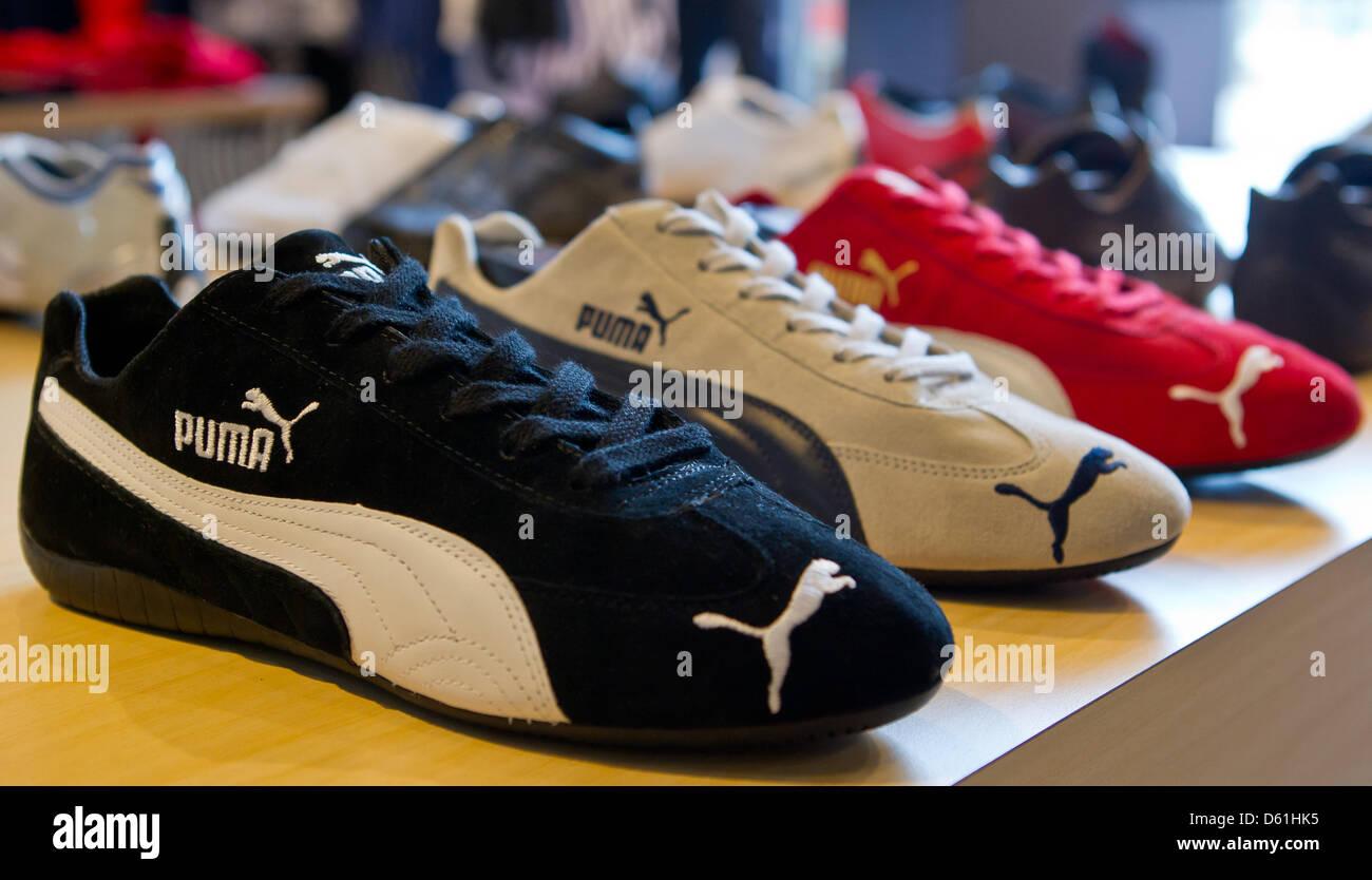 Der Sportartikelhersteller Puma Schuhe werden in einem Store