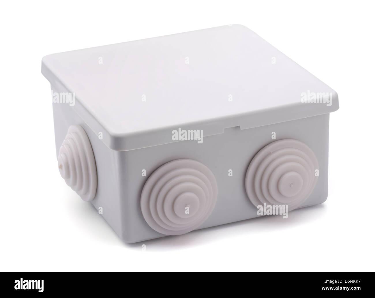 Graue Kunststoff elektrische Anschlussdose isoliert auf weiss Stockbild