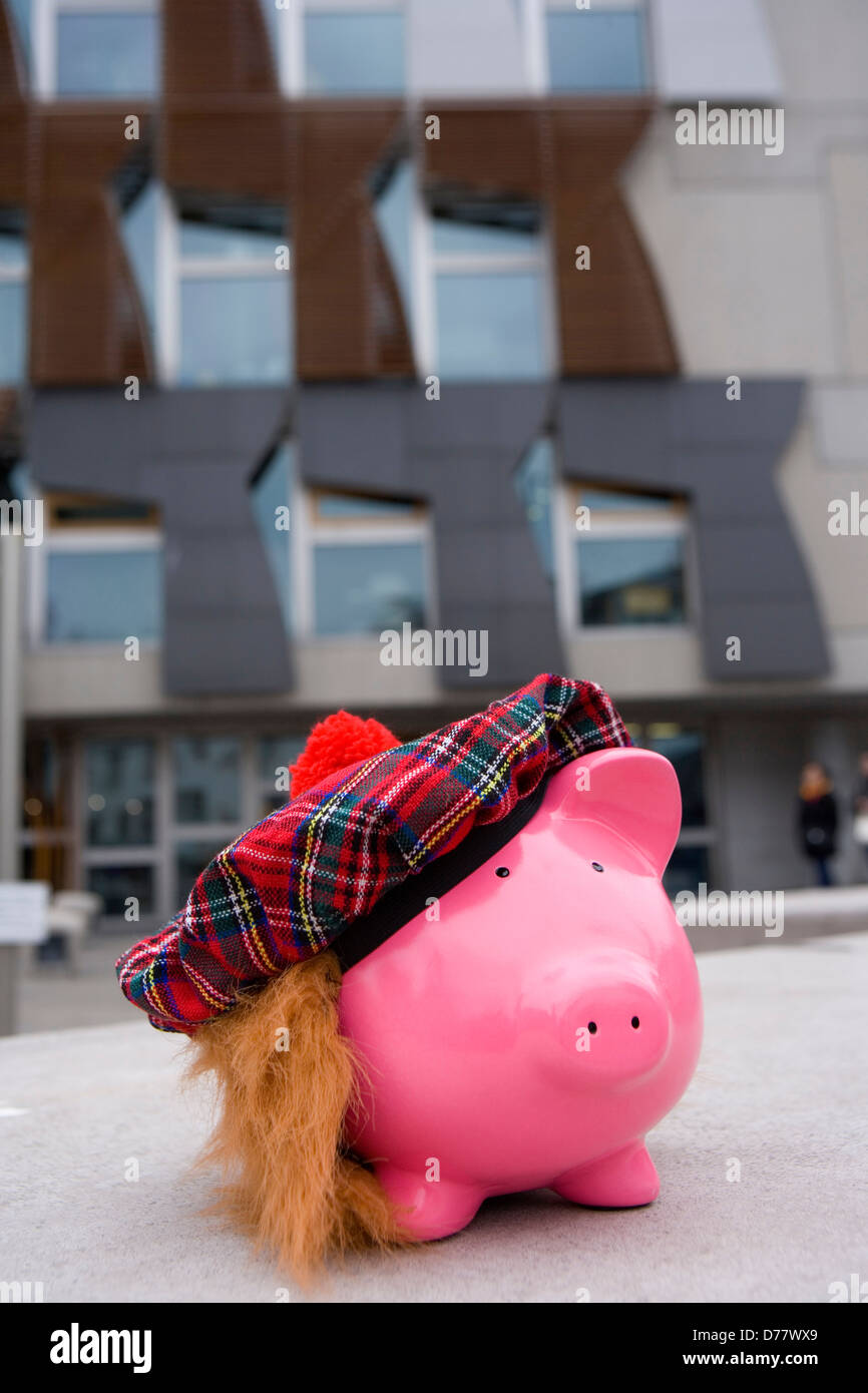 Schottisches Parlament, Geld zu sparen Stockbild