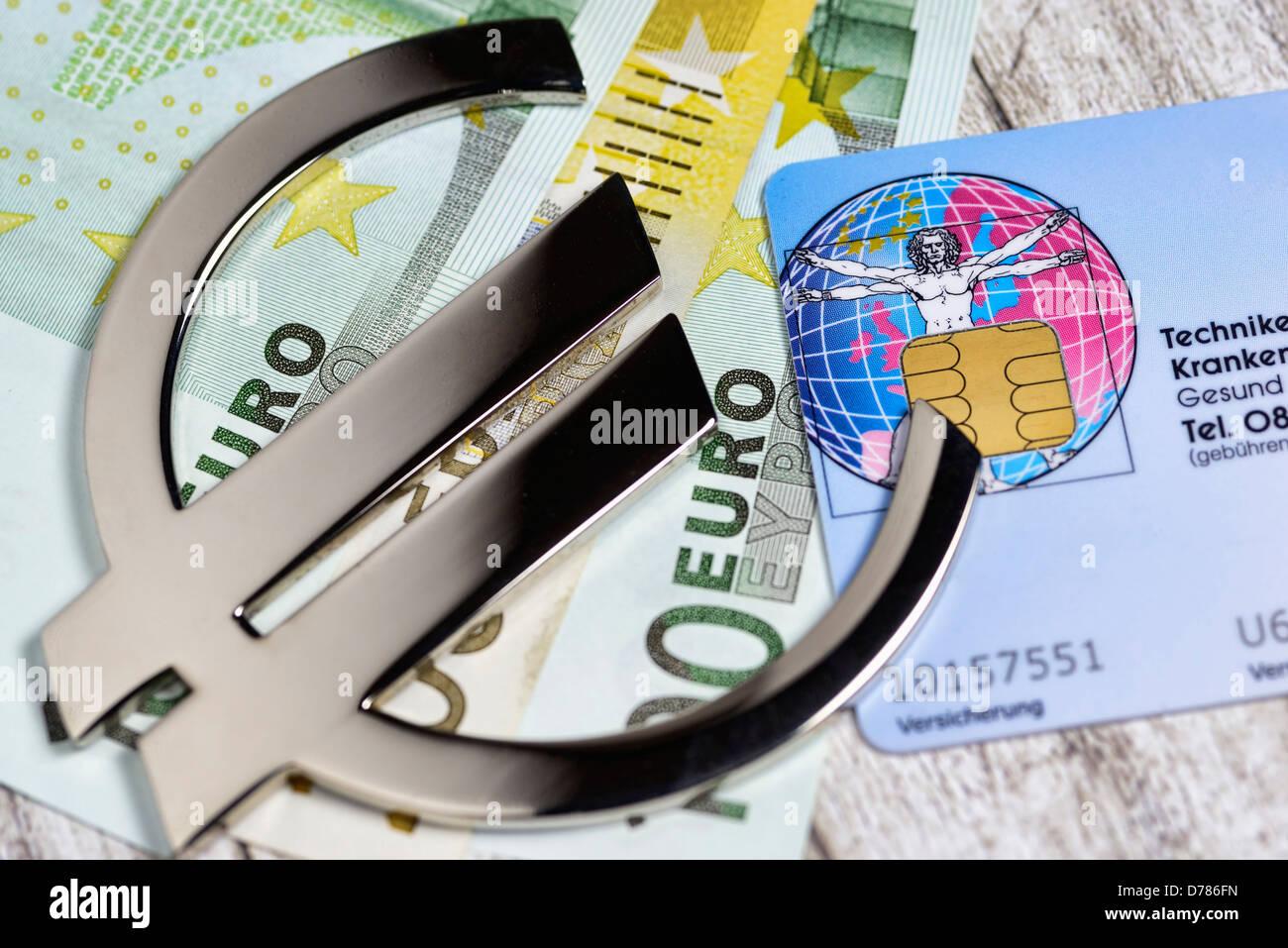 Eurosigns auf Gesundheit Karte und Banknoten, Gewinne mit den Krankenkassen Stockbild