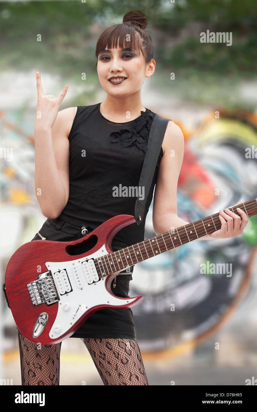 Junge Punk Rock Girl Stockbild