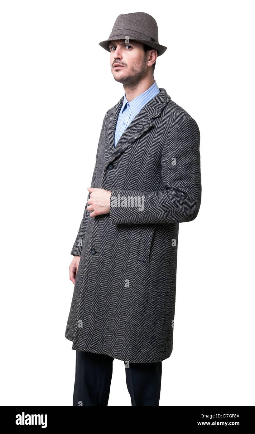 Eine Person gekleidet in grauen Mantel grauen Hut. Er