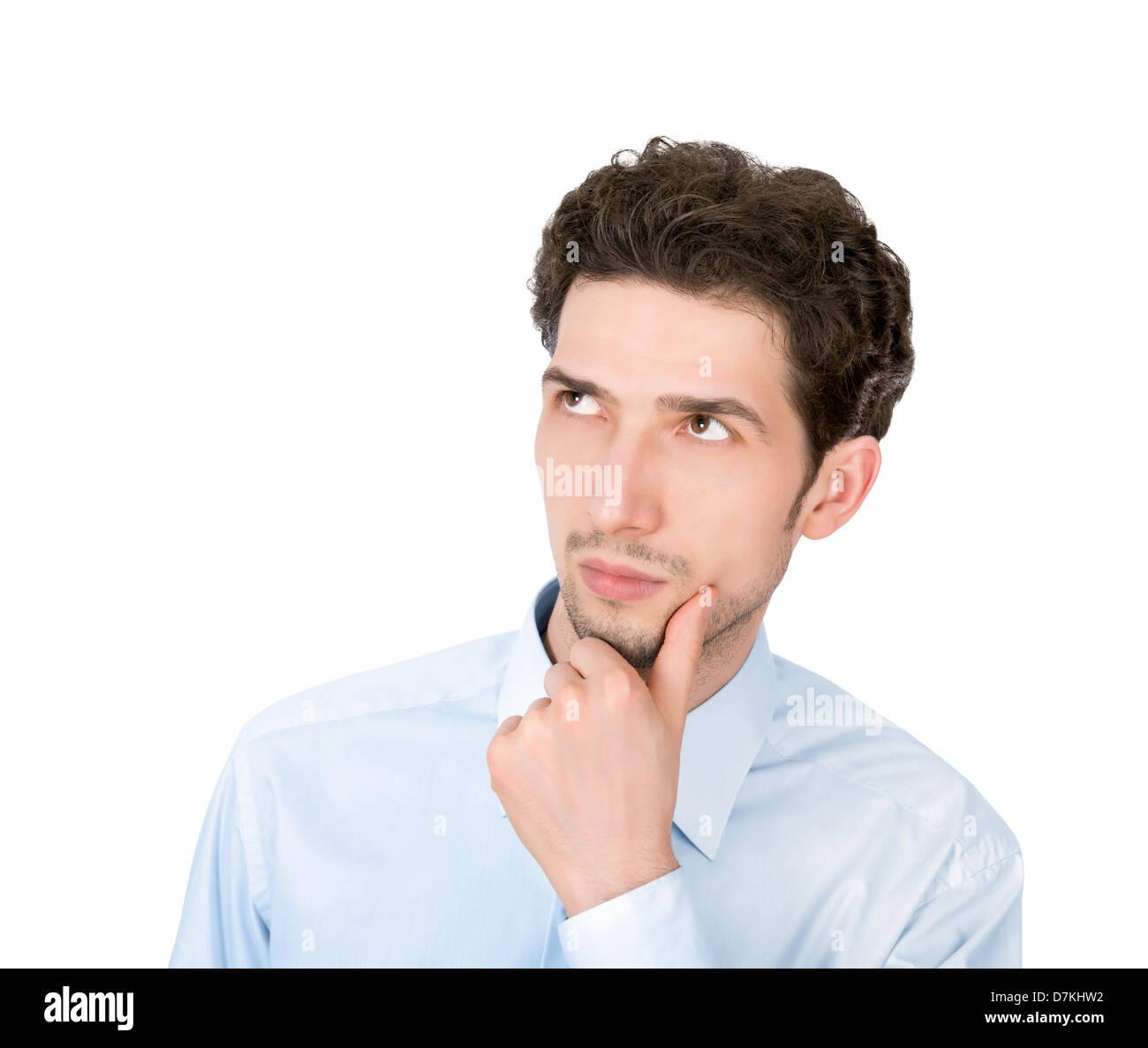 Porträt eines jungen hübschen ernsthaften Geschäftsmann Exemplar blickte. Isoliert auf weißem Hintergrund Stockfoto