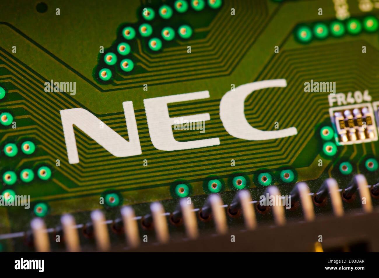 NEC-Logo auf Platine Stockbild