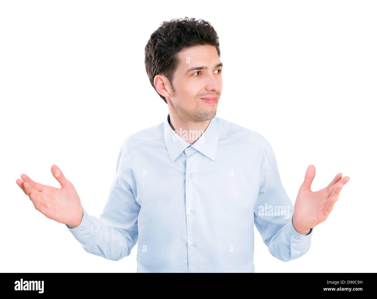 Porträt des jungen Geschäftsmann in Hemd mit Handflächen nach oben, die verwirrt, Ausdruck und keine Ideen. Isoliert Stockfoto