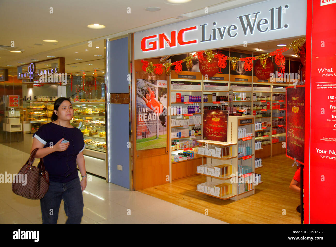 Singapur Bugis Junction einkaufen GNC Live Well Vordereingang Vitamine Gesundheit Stockbild