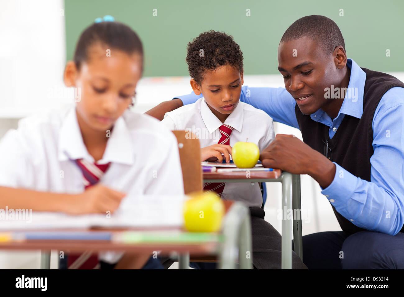 White Teacher Helping Black Student Stockfotos   White Teacher ... 4484b4ca49