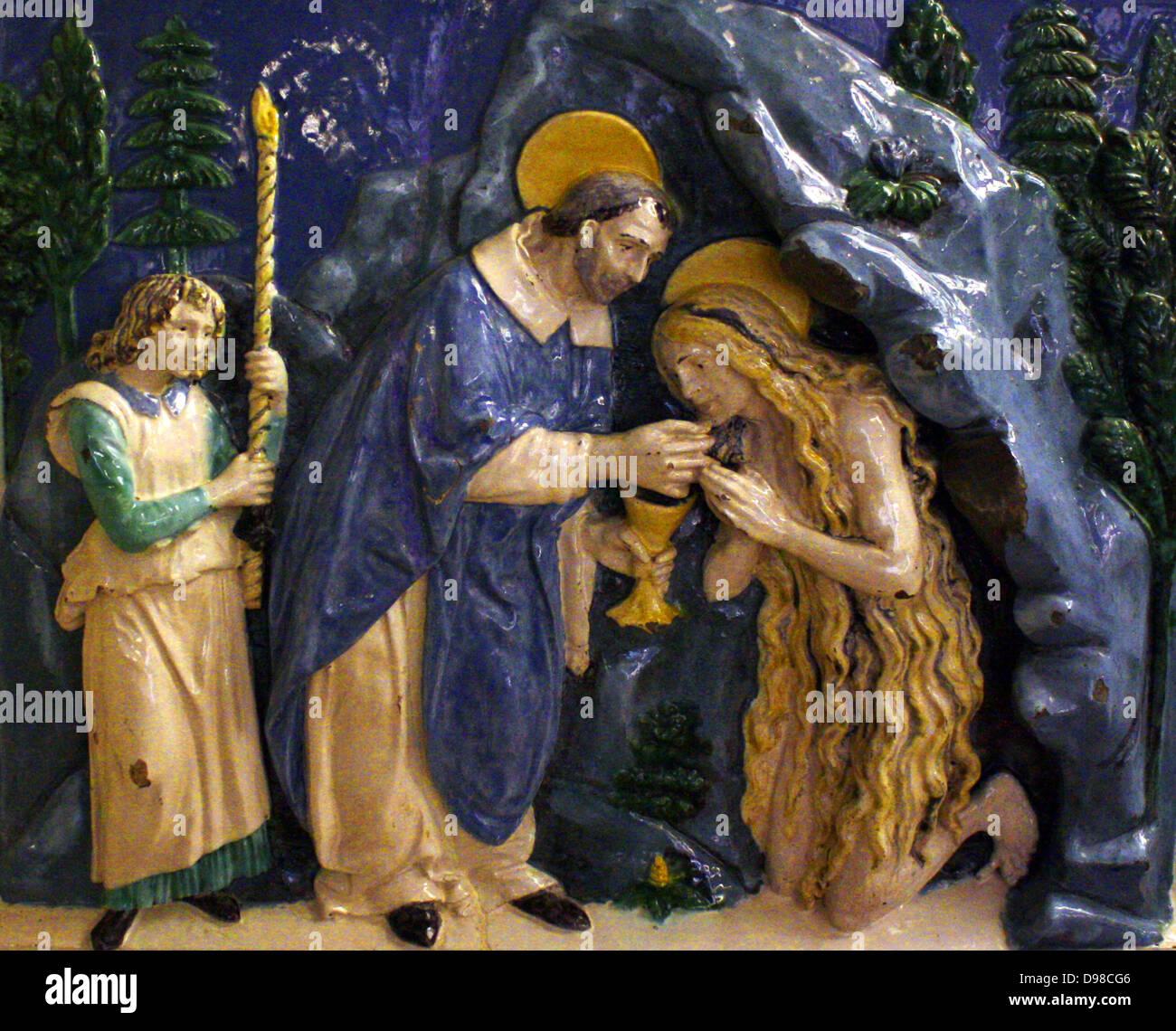 Werkstatt des Andrea Della Robbia (1435-1525) St. Mary Magdalene ihre letzte Kommunion empfangen.  Zinn-glasiertem Stockbild