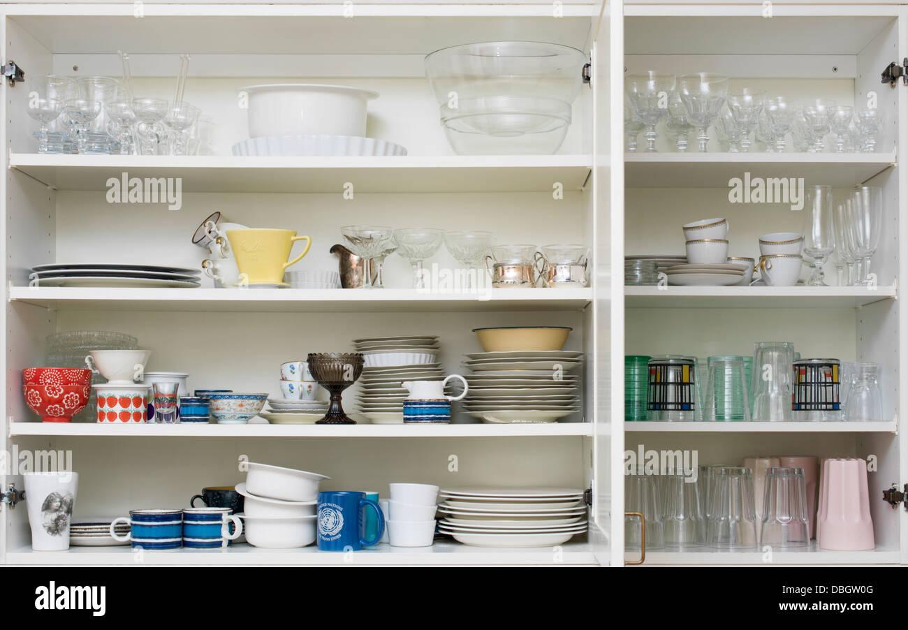 White Kitchen Cupboard With Glasses Stockfotos & White Kitchen ...