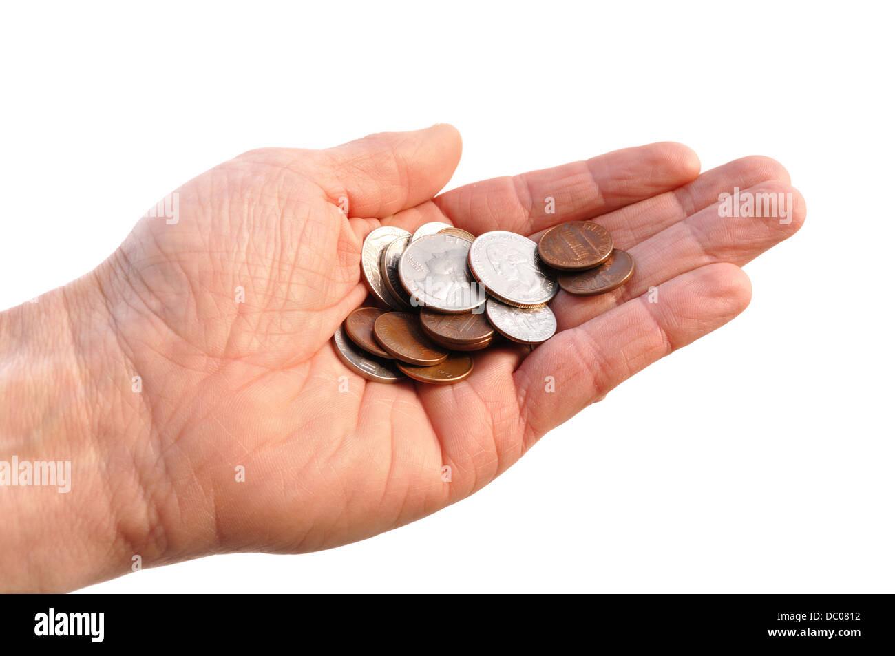Hand, die aus US-Währung Kleingeld Stockbild