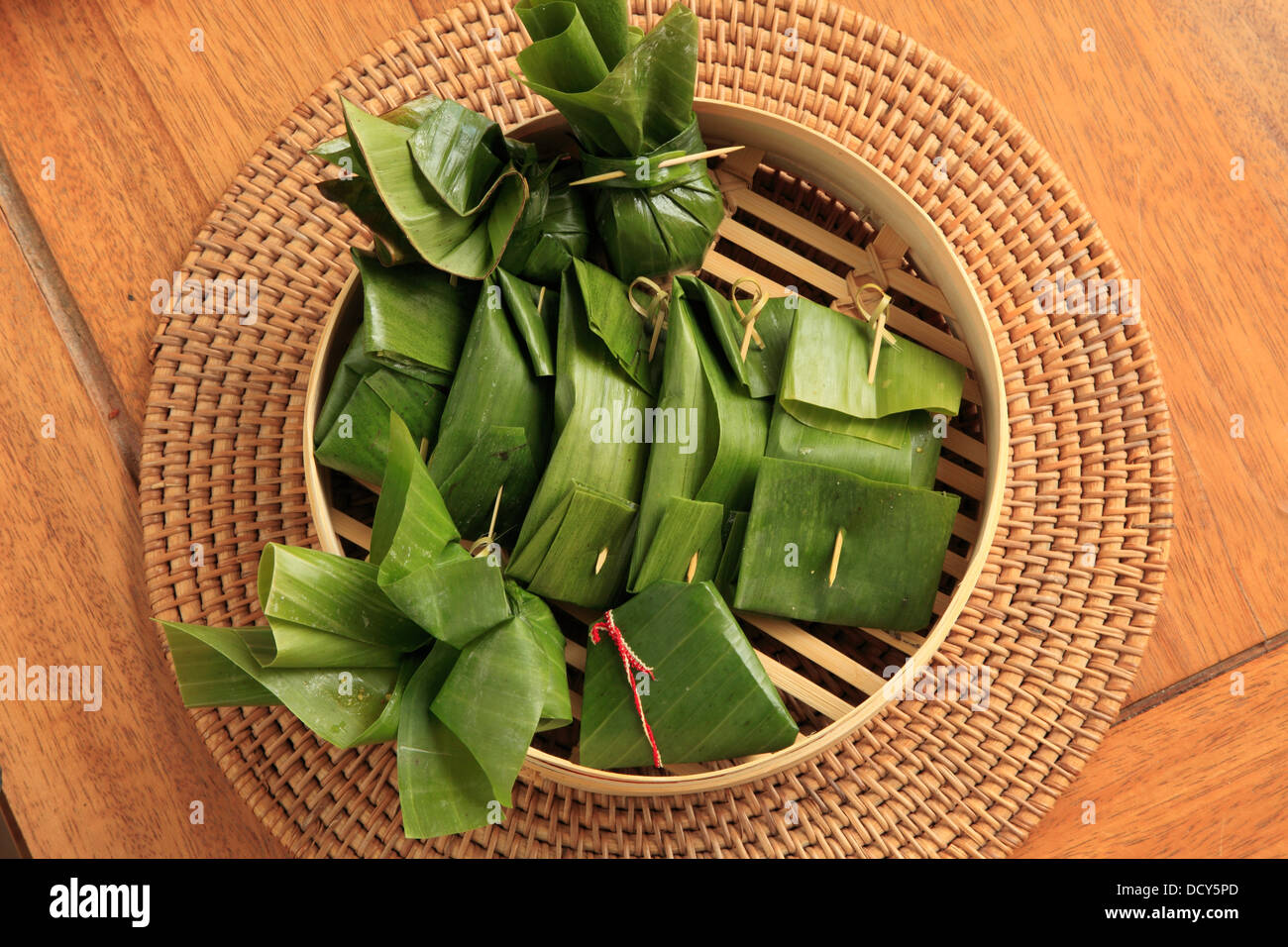 food banana leaves stockfotos food banana leaves bilder. Black Bedroom Furniture Sets. Home Design Ideas