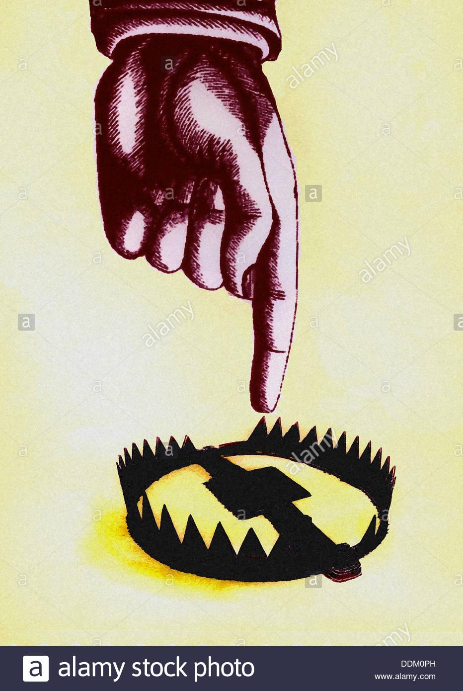 Finger zeigen in Richtung offene Falle Stockbild