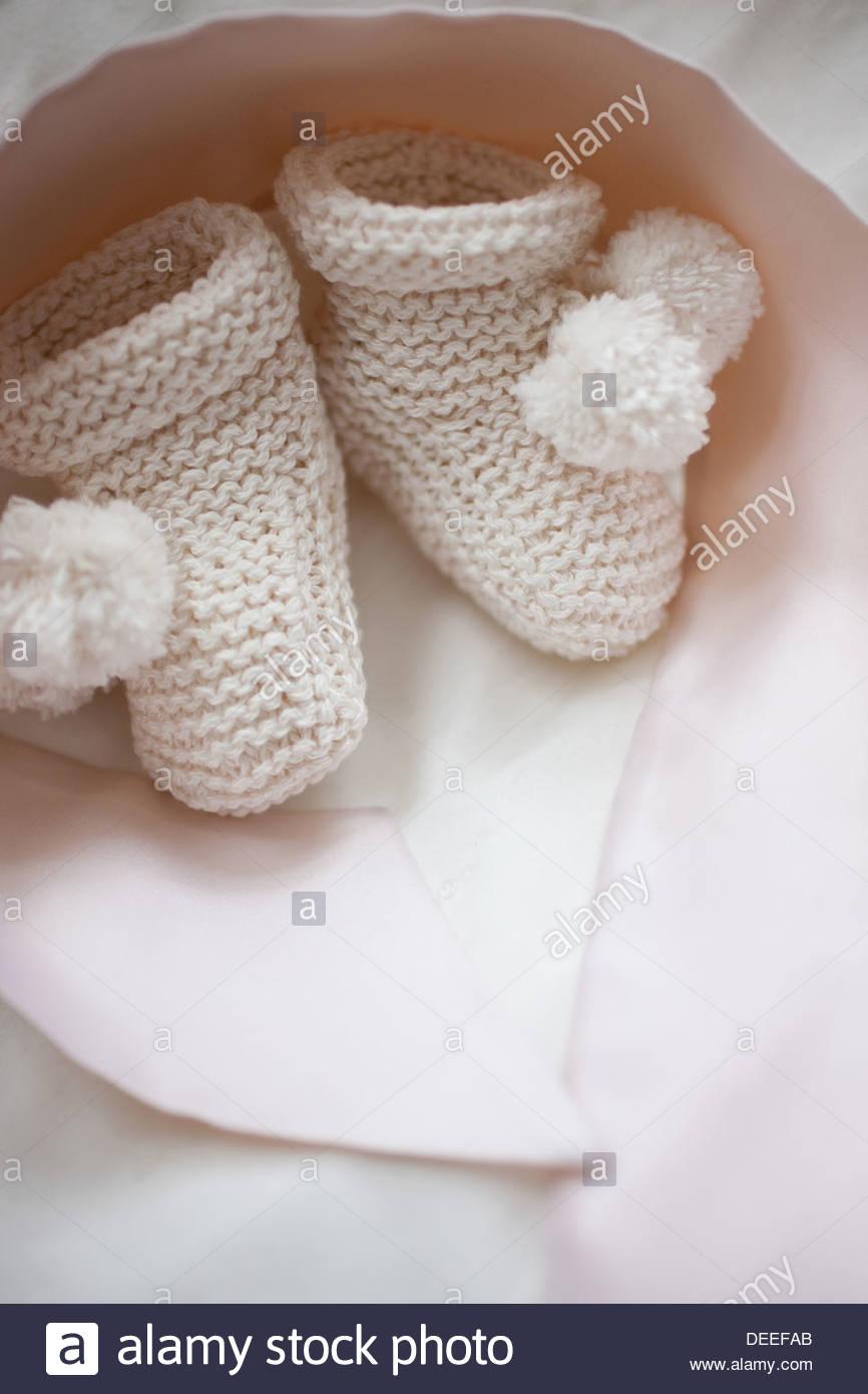 Nahaufnahme von stricken Baby booties Stockbild