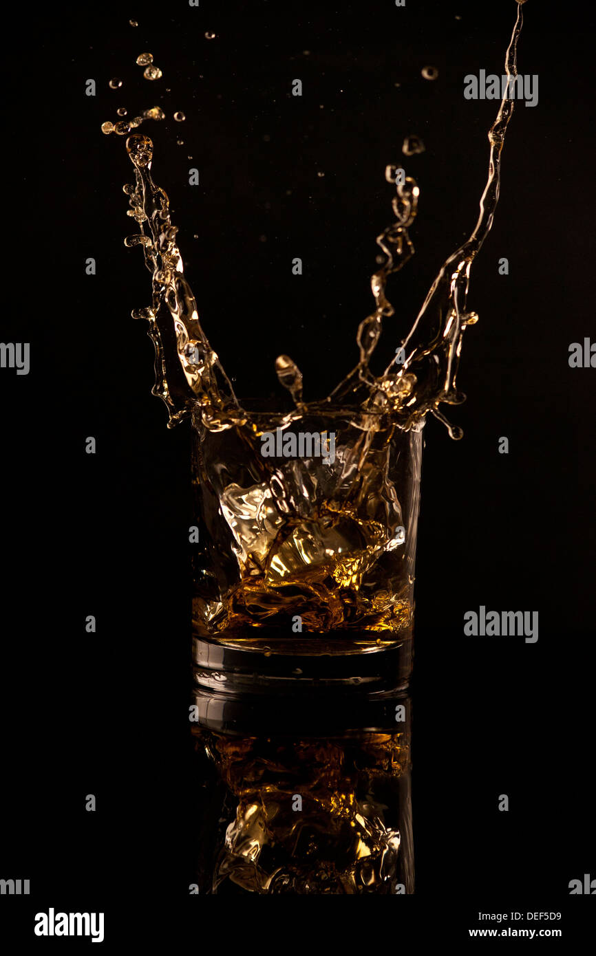 Whisky-splash Stockbild