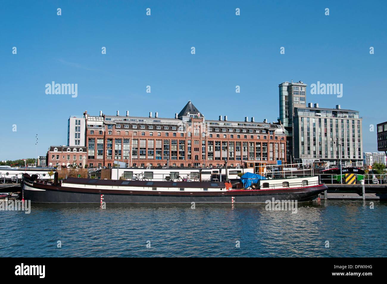 Apartments in Amsterdam Niederlande moderne Architektur auf Westerdoksdijkand zwischen Oude Houthaven und IJ port Hafen Kanal Stockbild