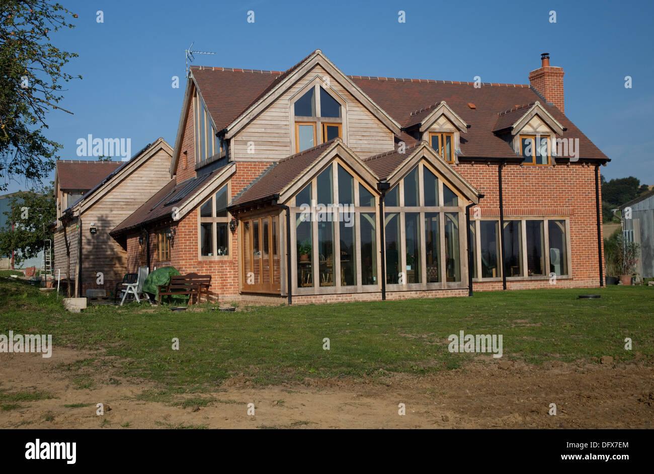 Holz Rahmen und Hemcrete Eco Neubau mit großen Eiche Wintergarten Mickleton UK Stockbild