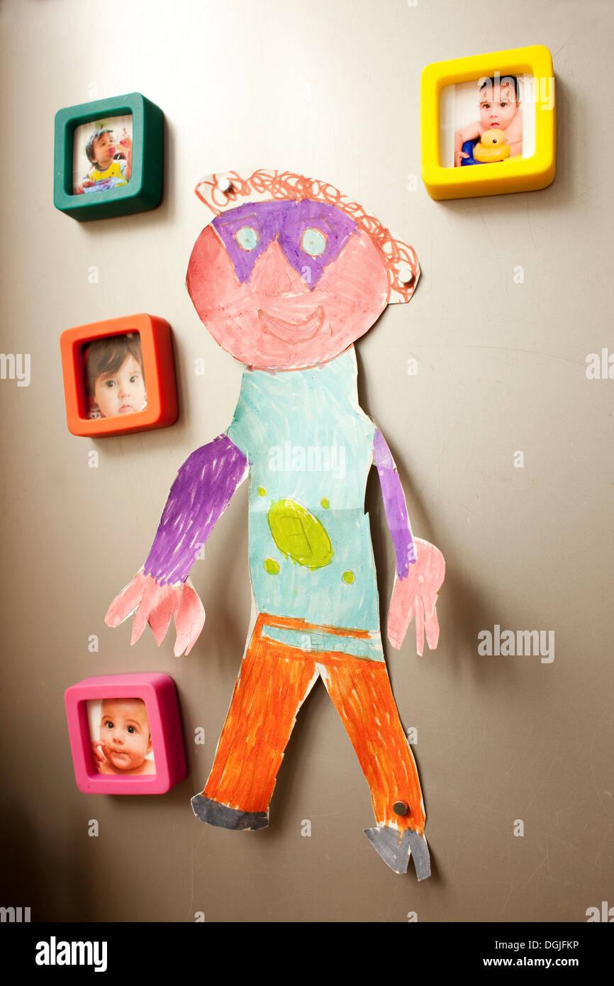 Kindheit-Fotografien und Bild an Wand Stockbild