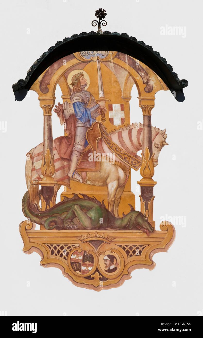 Wandmalerei auf der Fassade mit einem Dach, St. George am Pferd und Drache, Heiliger, Schutzpatron und heilige Helfer, Aschau Stockbild