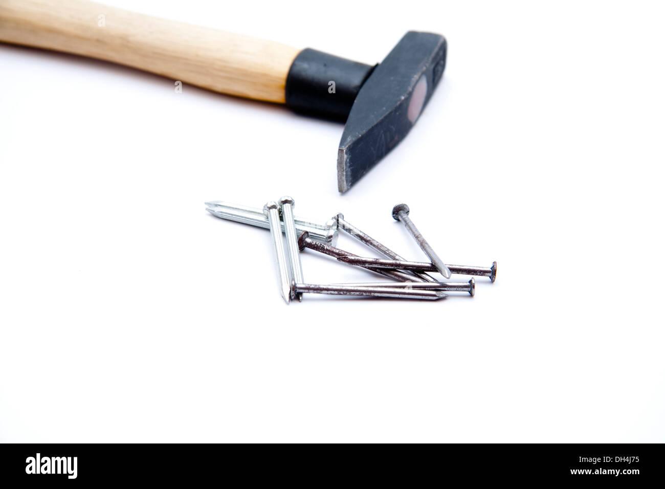 Nägel mit hammer Stockbild