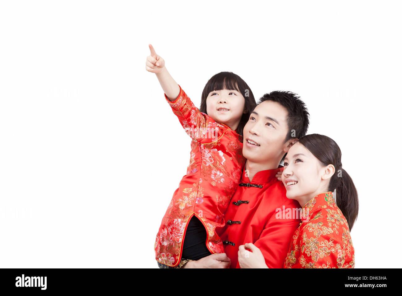 Familie mit drei tragen Kostüm Stockbild