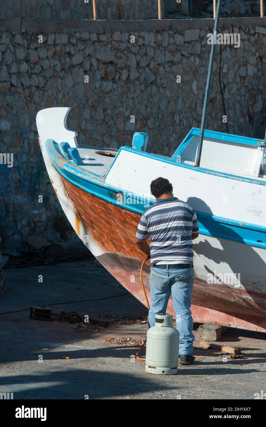 Griechenland, Dodekanes, Insel Chalki, Werftarbeiter Stockbild