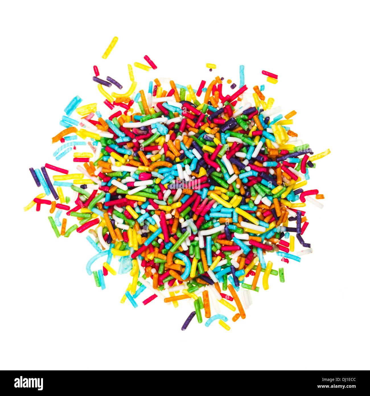 Dekoration, farbigen Zucker Jimmies isoliert auf weißem Hintergrund Stockfoto