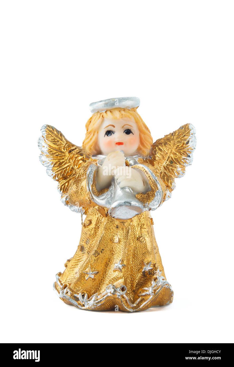 Eine kleine Miniatur-Statue eine bunte Engel mit Flügeln und Heiligenschein, Trompete zu spielen Stockbild