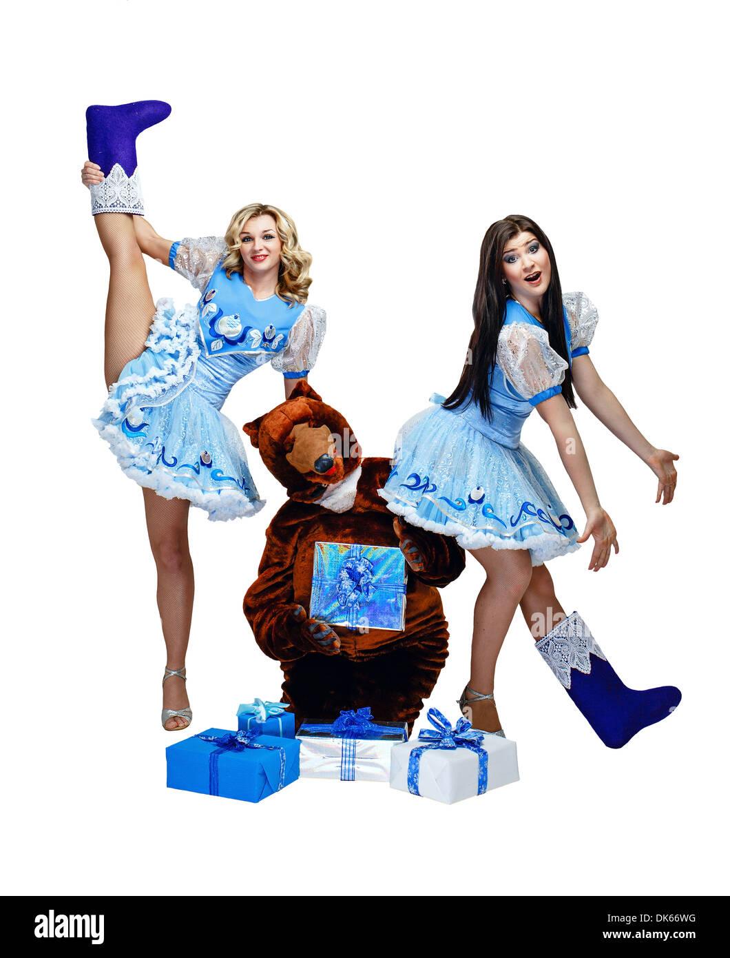 Attraktive junge Mädchen im Schnee Mädchen Kostüm stehen als ...