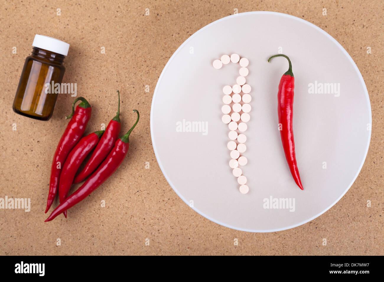 Gesunde Ernährung-Konzept. Rote Chilischoten als gute Quelle für Vitamine. Stockbild