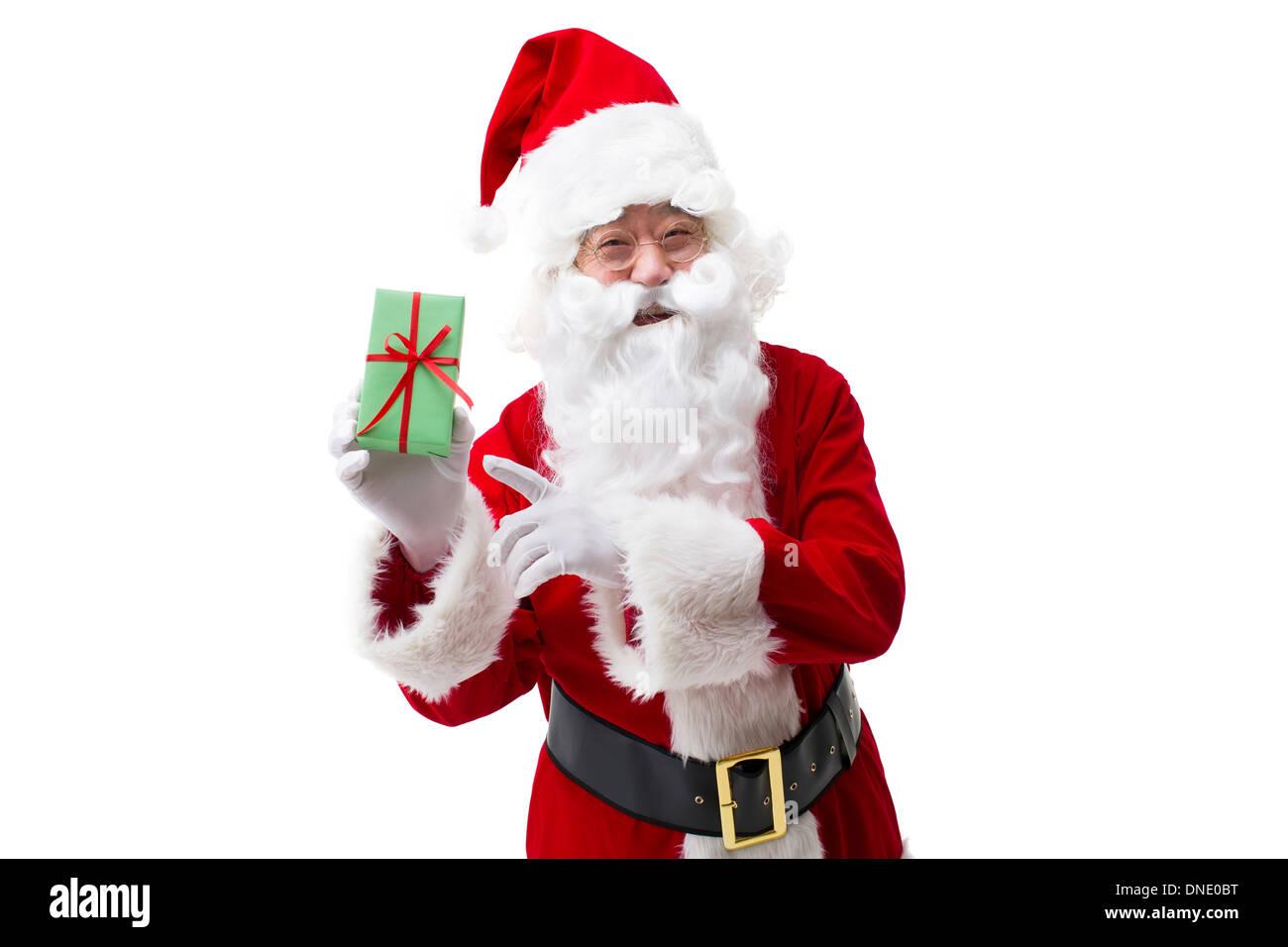 Santa Claus mit Weihnachtsgeschenk Stockfoto