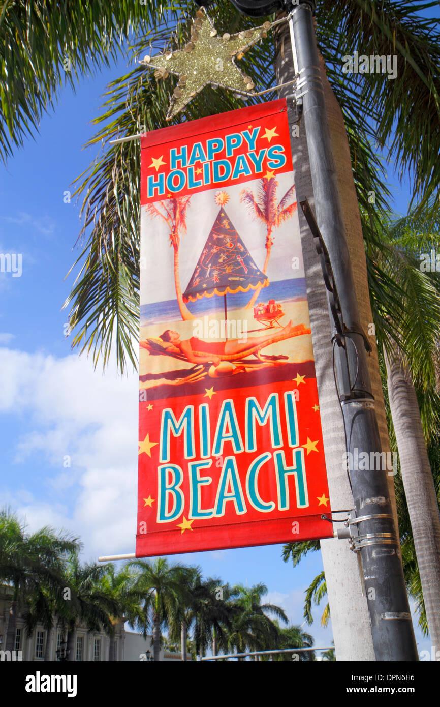 Miami Beach Florida 41st Street Arthur Godfrey Boulevard Banner Frohe Feiertage Stadt Stockfoto