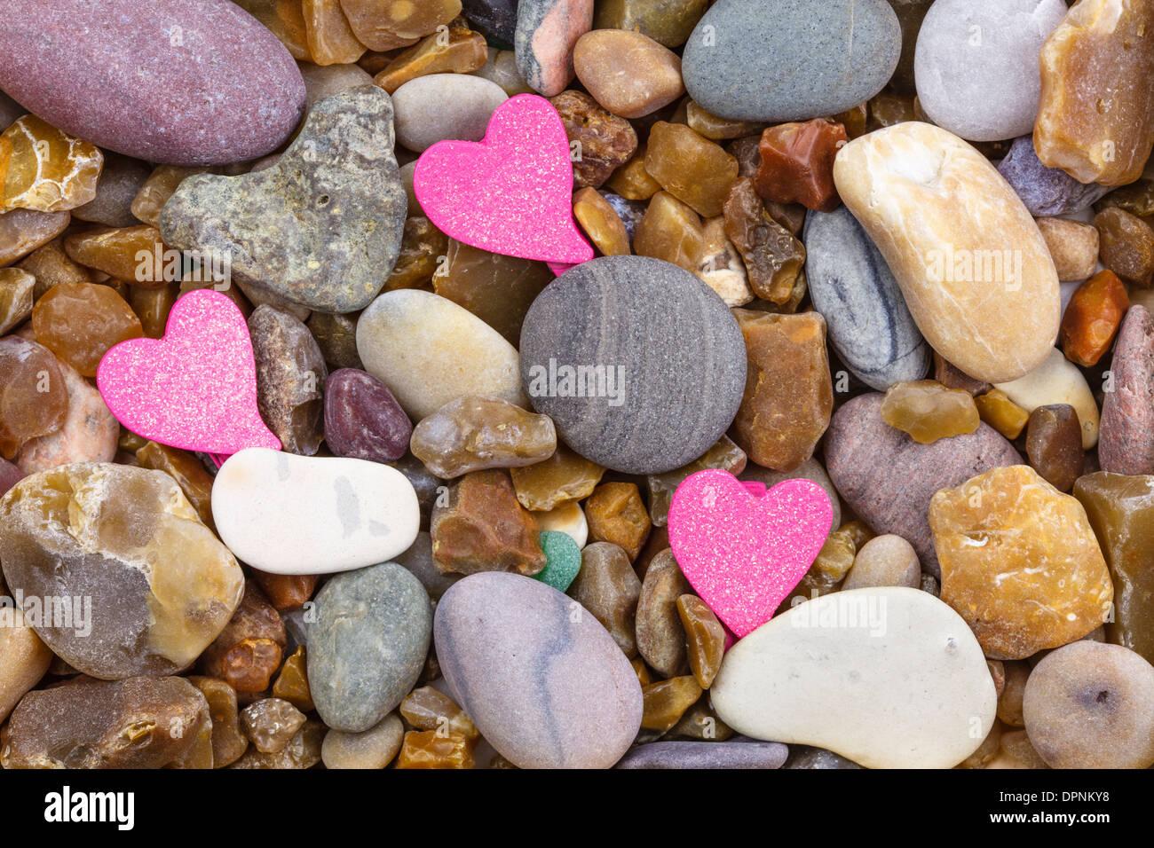 3 Herzen auf Pebble Stockbild