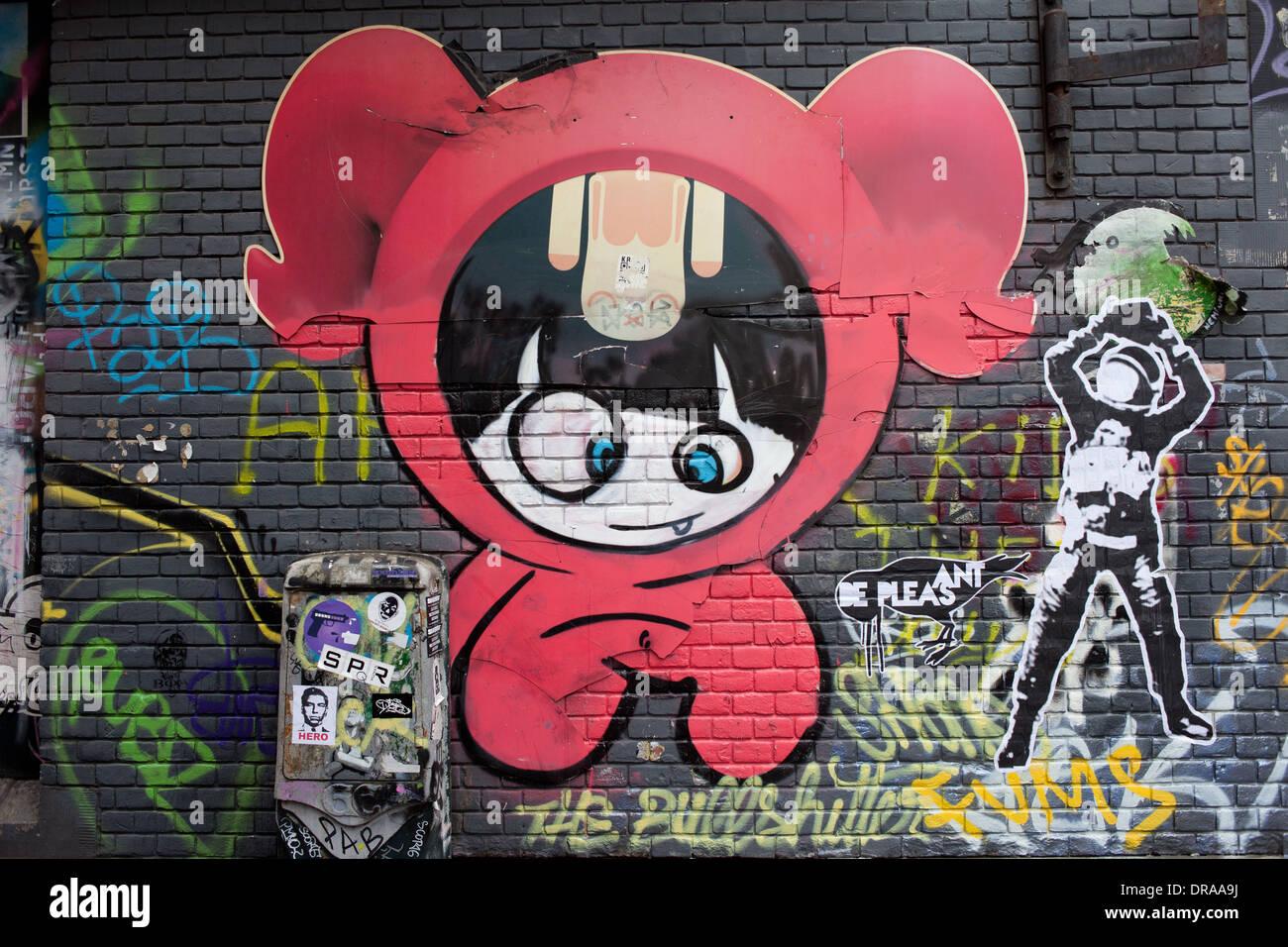 Cartoon Charakter Graffiti auf einer schwarz bemalten Mauer in Amsterdam, Holland, Niederlande. Stockbild