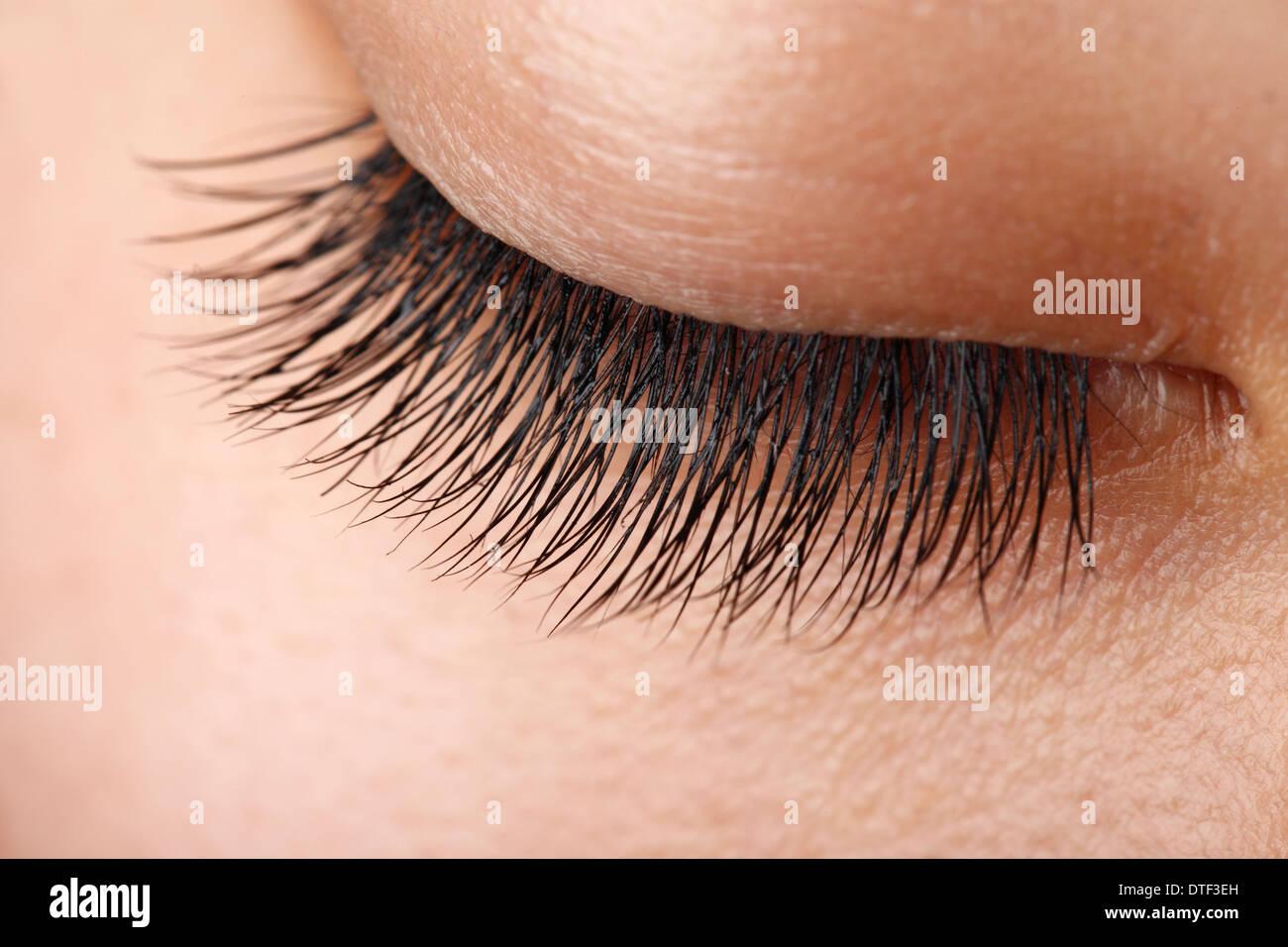 Detailansicht des schönen Asiatin Wimpern Stockbild