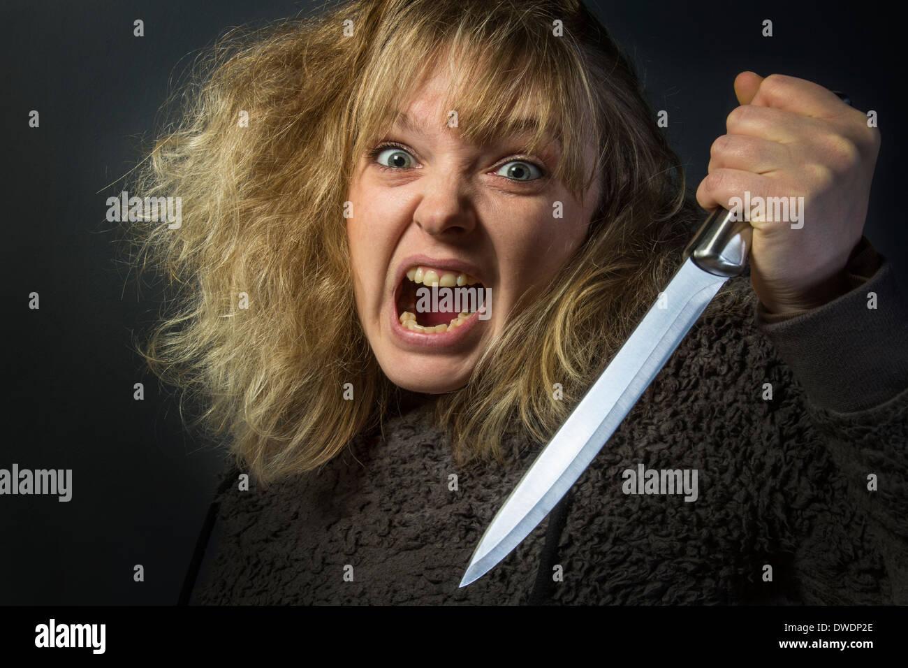 Psychotischen junge Frau - häusliche Gewalt Stockbild