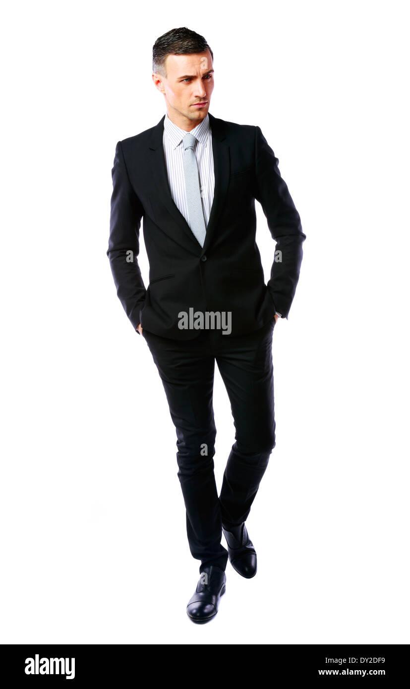 Porträt eines zuversichtlich Geschäftsmann zu Fuß auf einem weißen Hintergrund isoliert Stockbild
