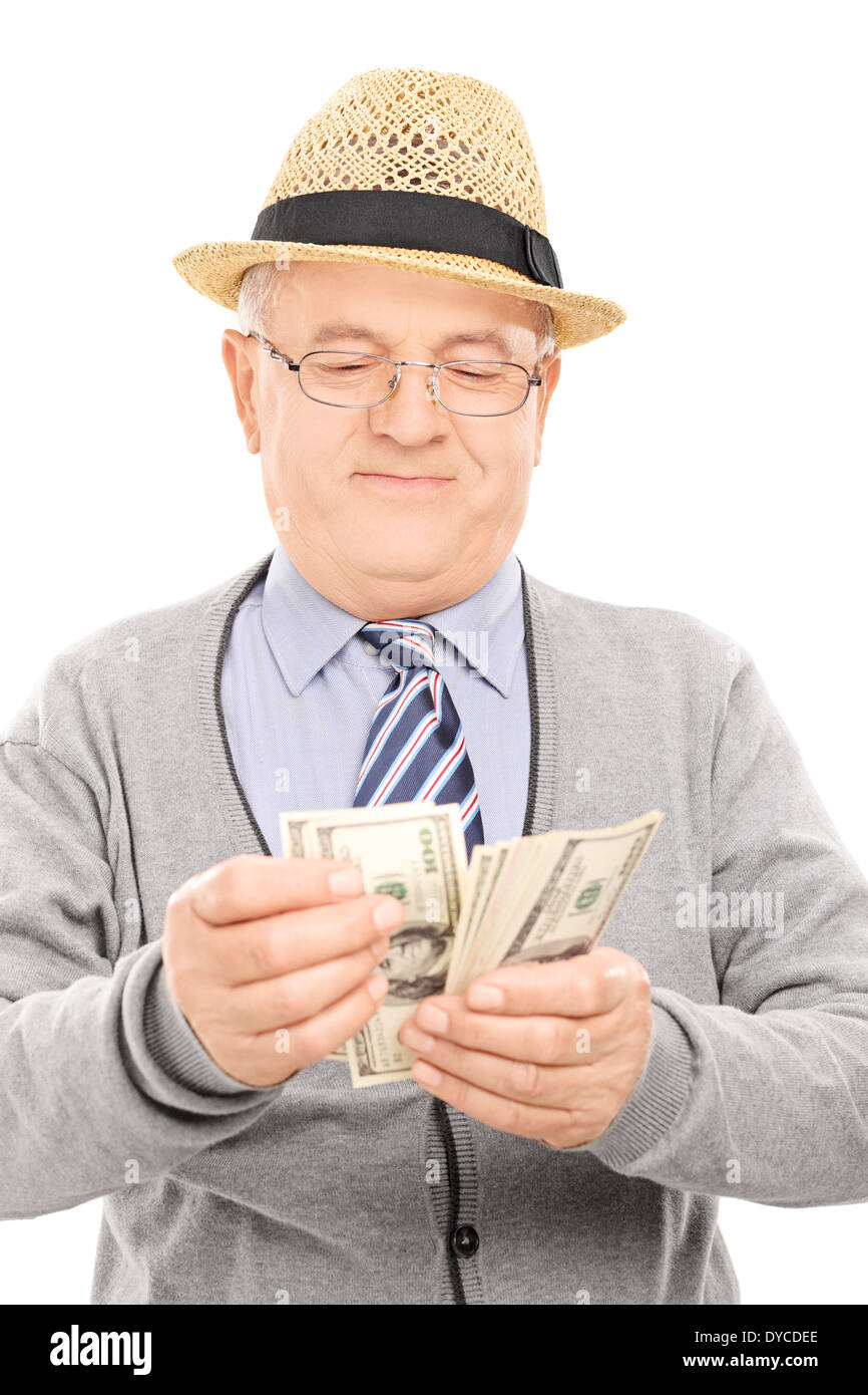 Ältere Gentleman Geldzählen Stockbild