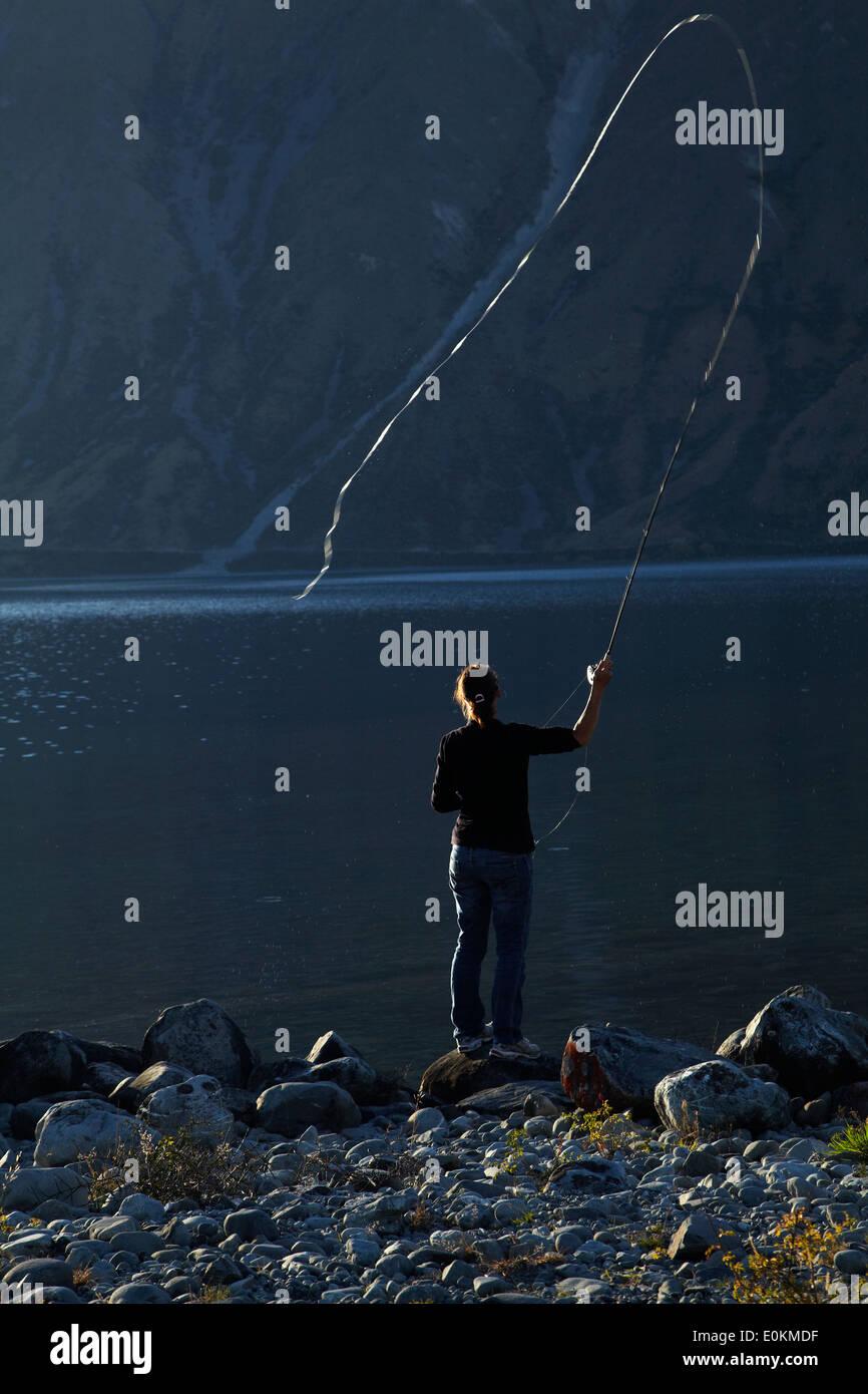 Fliegenfischen Sie, Lake Ohau, Mackenzie Country, South Canterbury, Südinsel, Neuseeland Stockbild