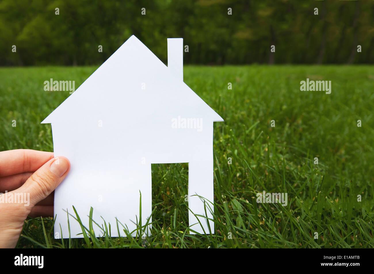 Immobilien-Konzept, Hand, hält Haus Stockbild