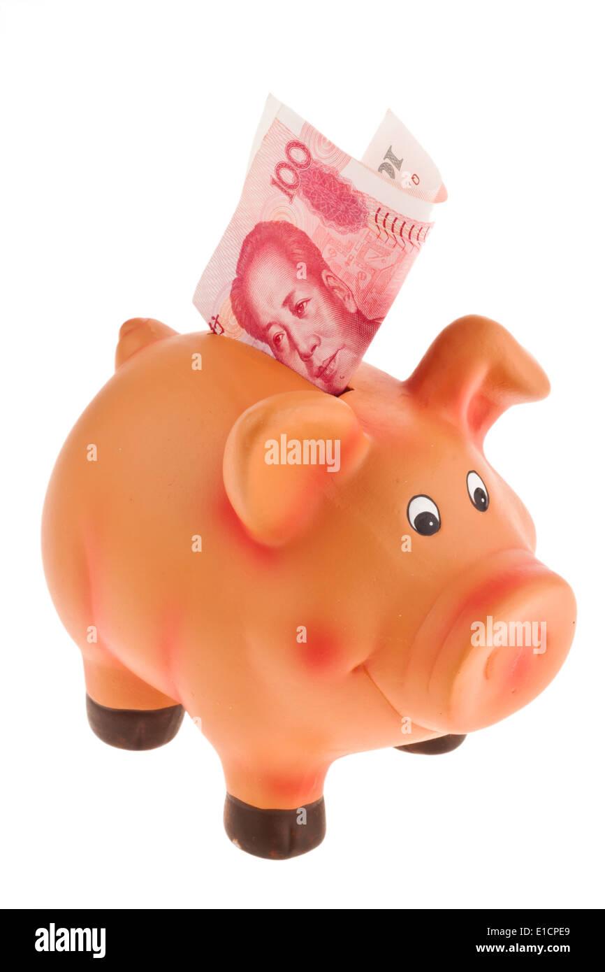 Chinesische Yuan Banknoten und ein Sparschwein.Vor einem weißen Hintergrund Stockfoto