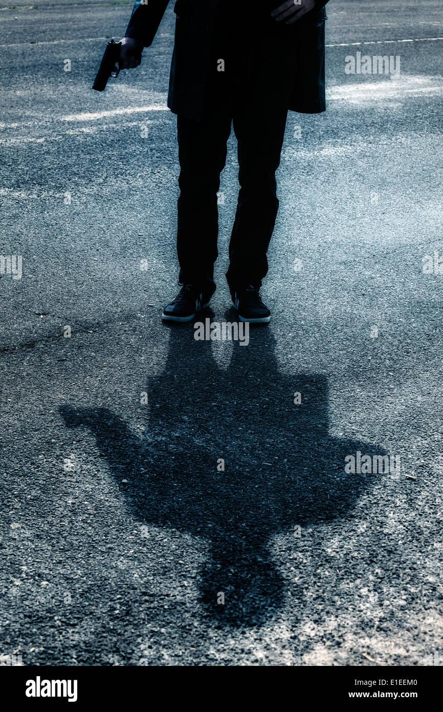 Schatten von einem Mann mit einem Gewehr Stockbild