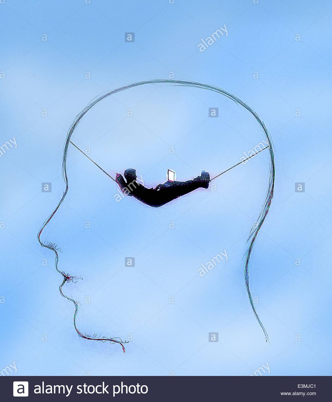 Geschäftsmann mit Laptop entspannend im Kopf des Mannes Stockbild
