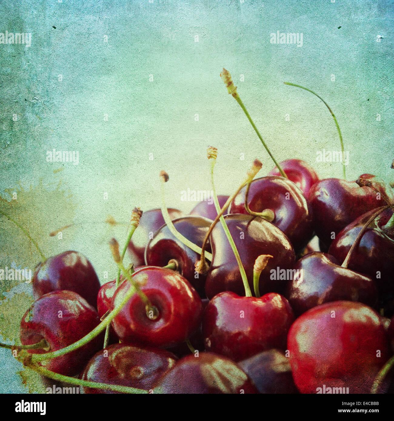 Vintage-Hintergrund mit Kirschen Stockbild