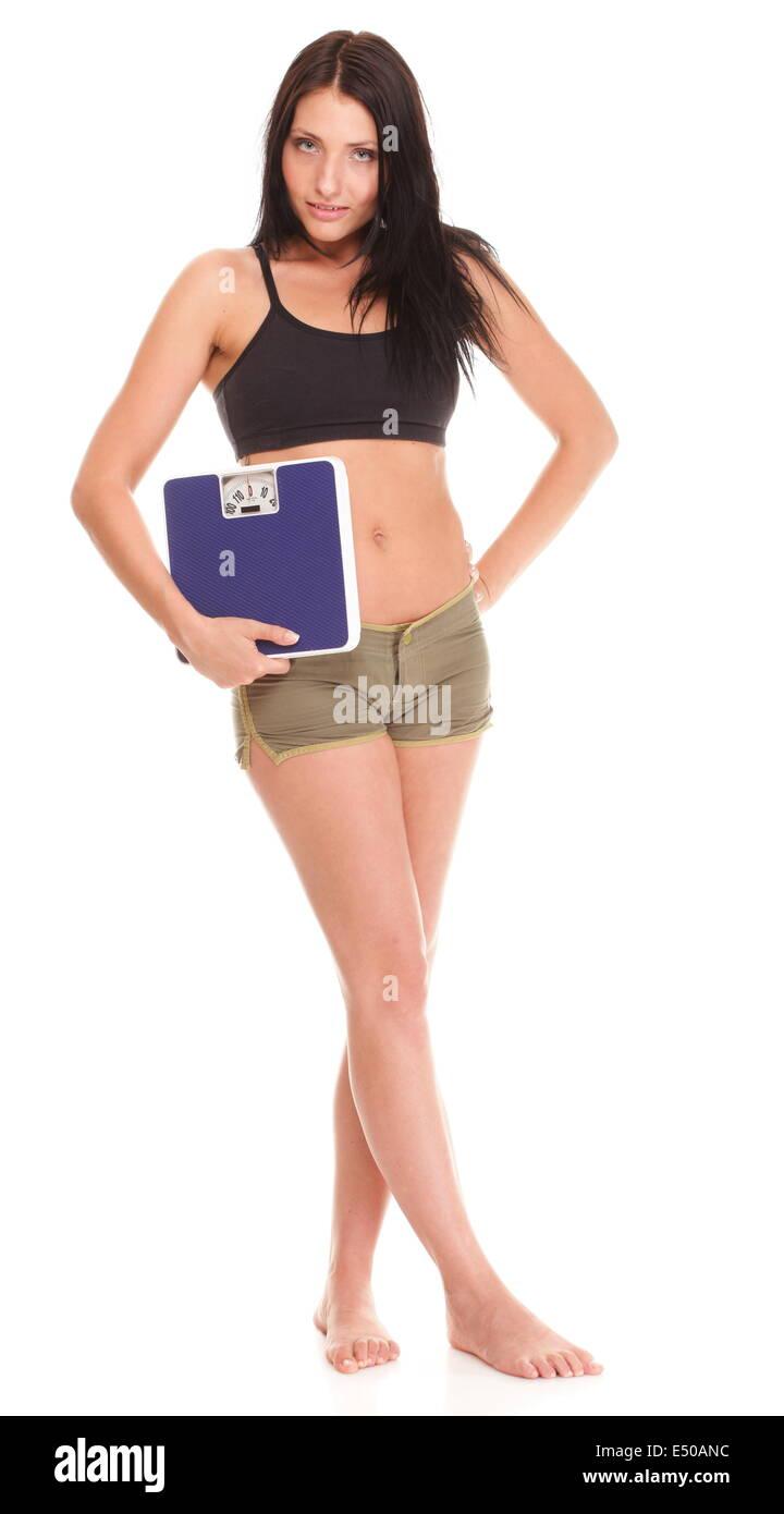 Gewicht-Verlust-Frau im Maßstab unglücklich Stockbild