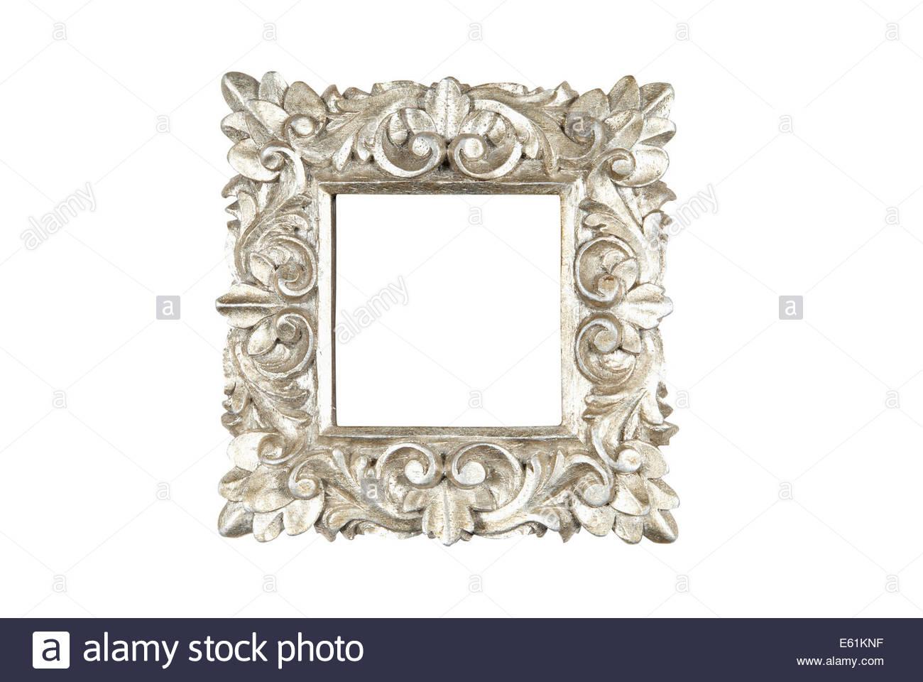 Eine reich verzierte floralen Design quadratischen Holzrahmen in Silber lackiert. Isoliert auf weiss mit Pfad. Stockbild