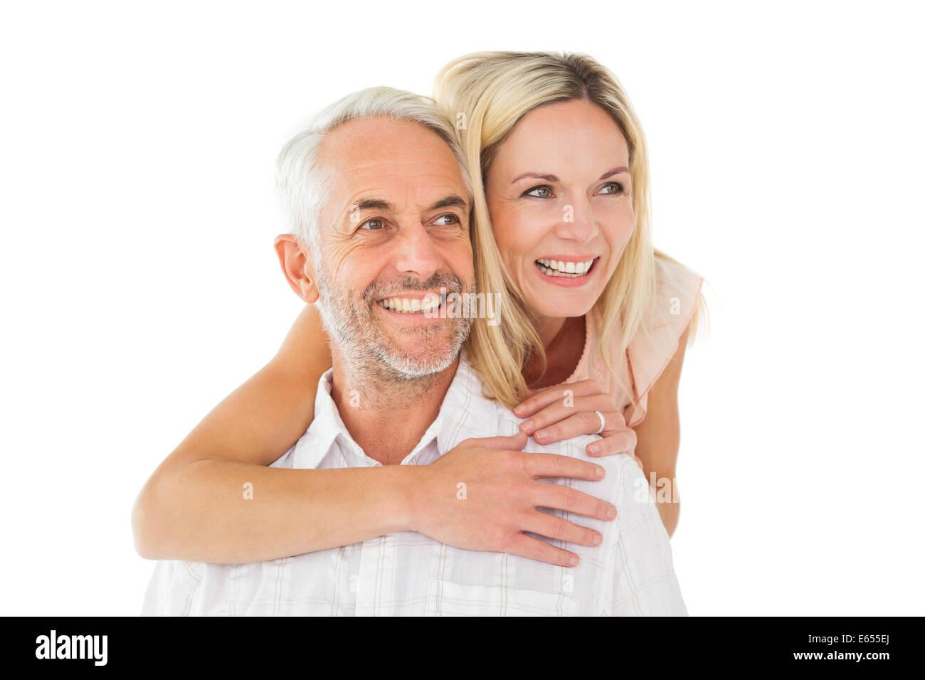 Glücklicher Mann mit seinem Partner eine Huckepack Stockbild